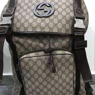4178036edb8d Authentic Gucci GG Supreme Canvas Interlocking G Backpack.