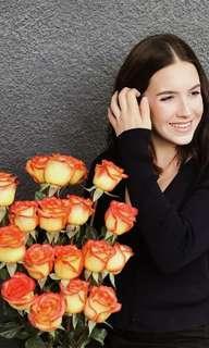 A box of 12 orange roses