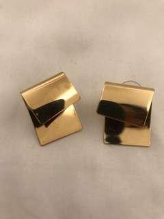 Folded gold stud earrings