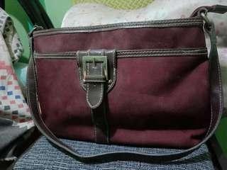 elegant maroon flat bag