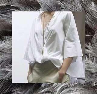Low neck white blouse