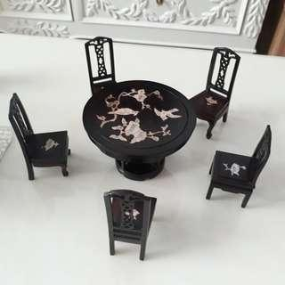 Set of miniature handcrafted table and chairs