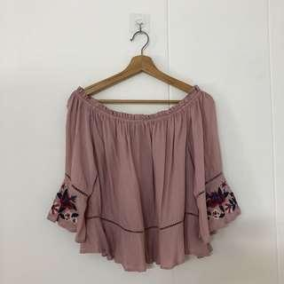 Purple off shoulder top with embroidered flowers