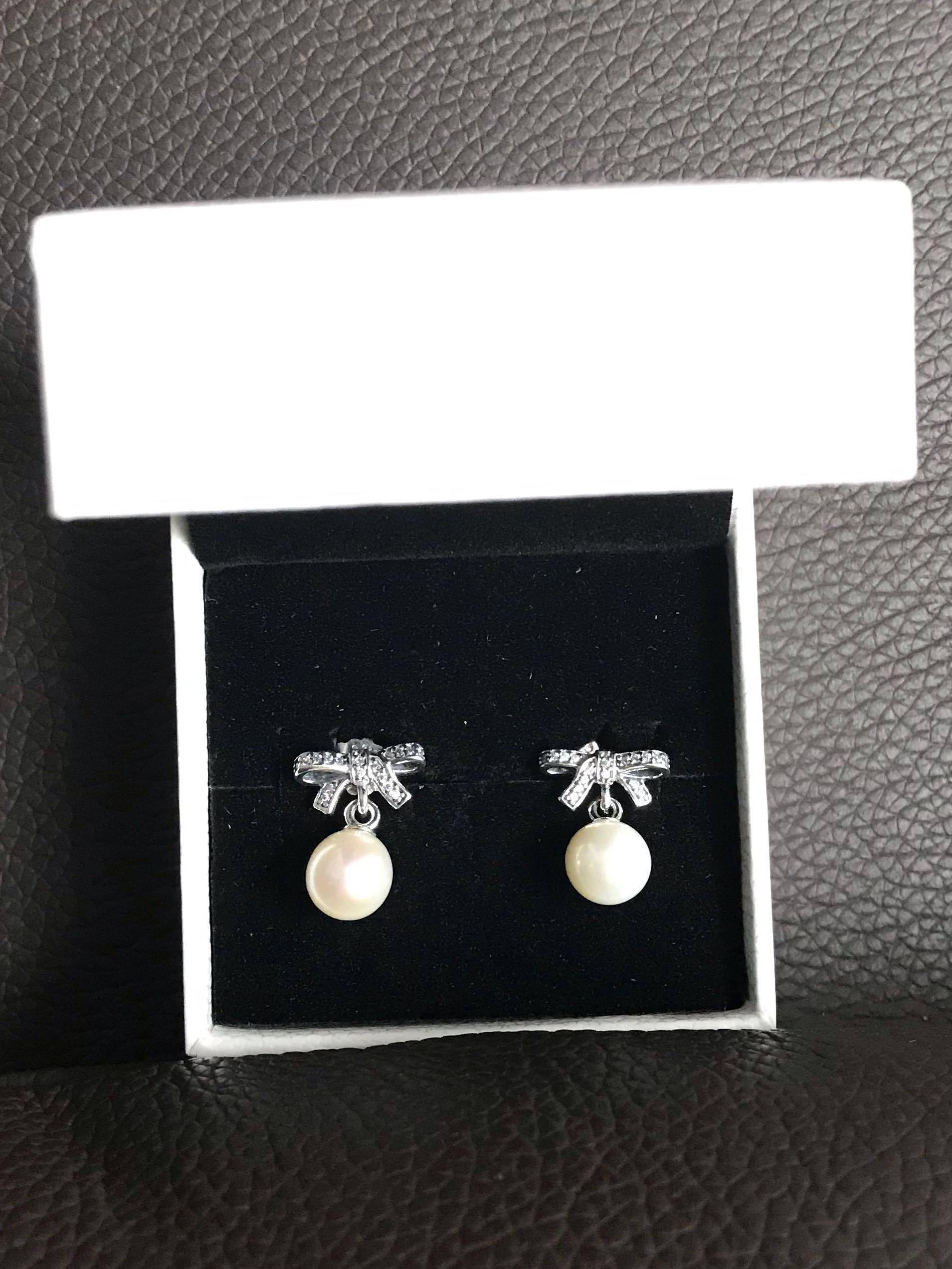 67abc6ae4 Pandora Delicate Sentiments, White Pearl & Clear CZ Earrings, Women's  Fashion, Accessories, Others on Carousell