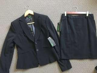 Black work suit jacket and suit skirt