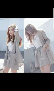 Grey outerwear and shorts