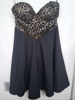 Blossom black dress with gold details on bustier