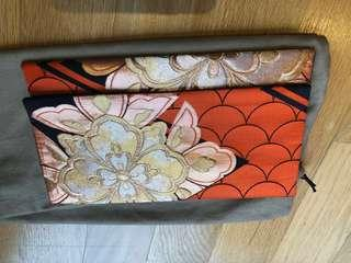Orange flowers motive clutch