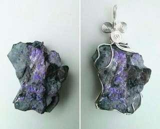 Raw sugilite pendant in wire wrapped silver filled wire