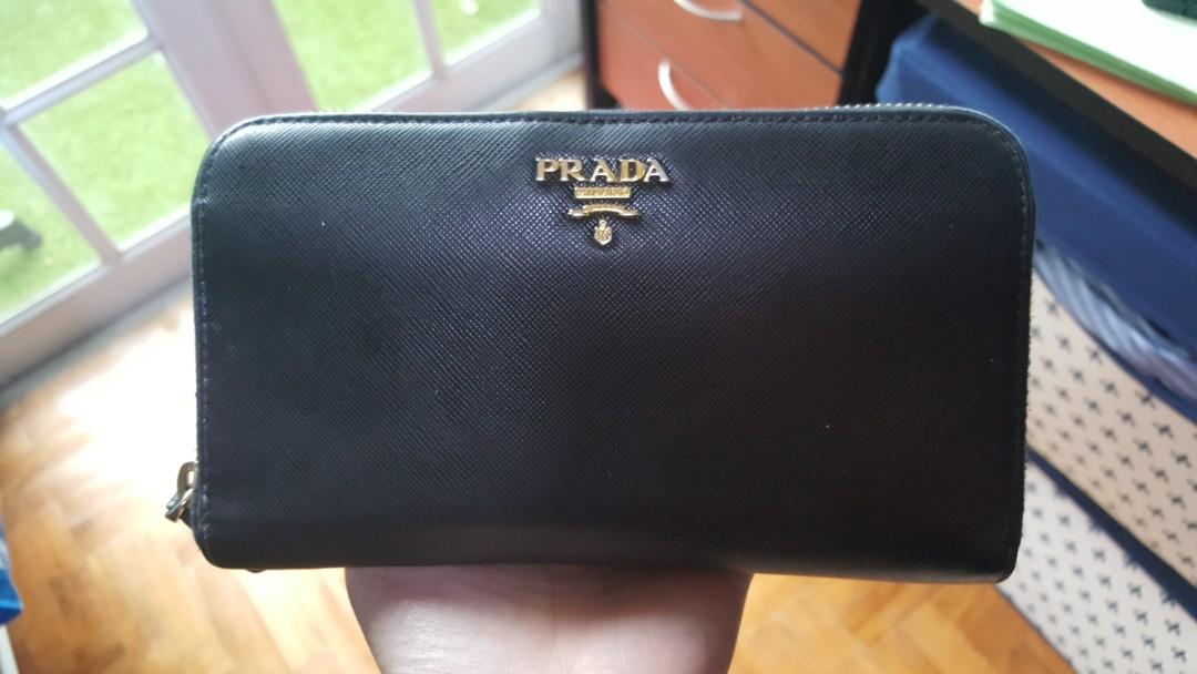 5107a37bdf10b2 Authentic Prada Saffiano Leather zip around long wallet (black ...