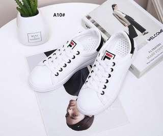 F I L A Sport Sneakers Shoes..... Kode A10#21  Bahan Faux Calf Leather  Dalaman Faux Soft Leather  Kwalitas Semi Premium Keren cantik nyaman di kaki Berat dengan box 0.6kg Rubber Sole 2cm  Warna ; -White/Black 36  Insole ; 36 : 22cm 37 : 22.