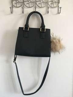 Black handbag with fur