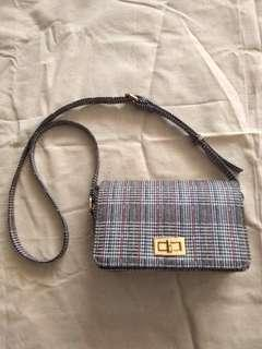 Voir checked Sling Bag