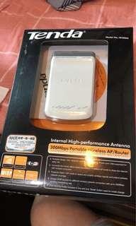 Tenda w300m portable wireless access point / router