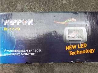 """Slightly used Universal 7"""" widescreen LCD Headrest"""