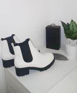 black and white heeled boots