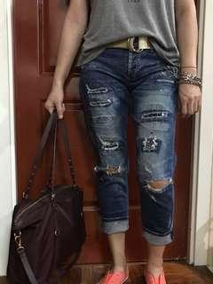 Patched ripped jeans