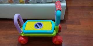 Taf Toys 4 in 1 Walker, Ride-on, Wagon and toy box