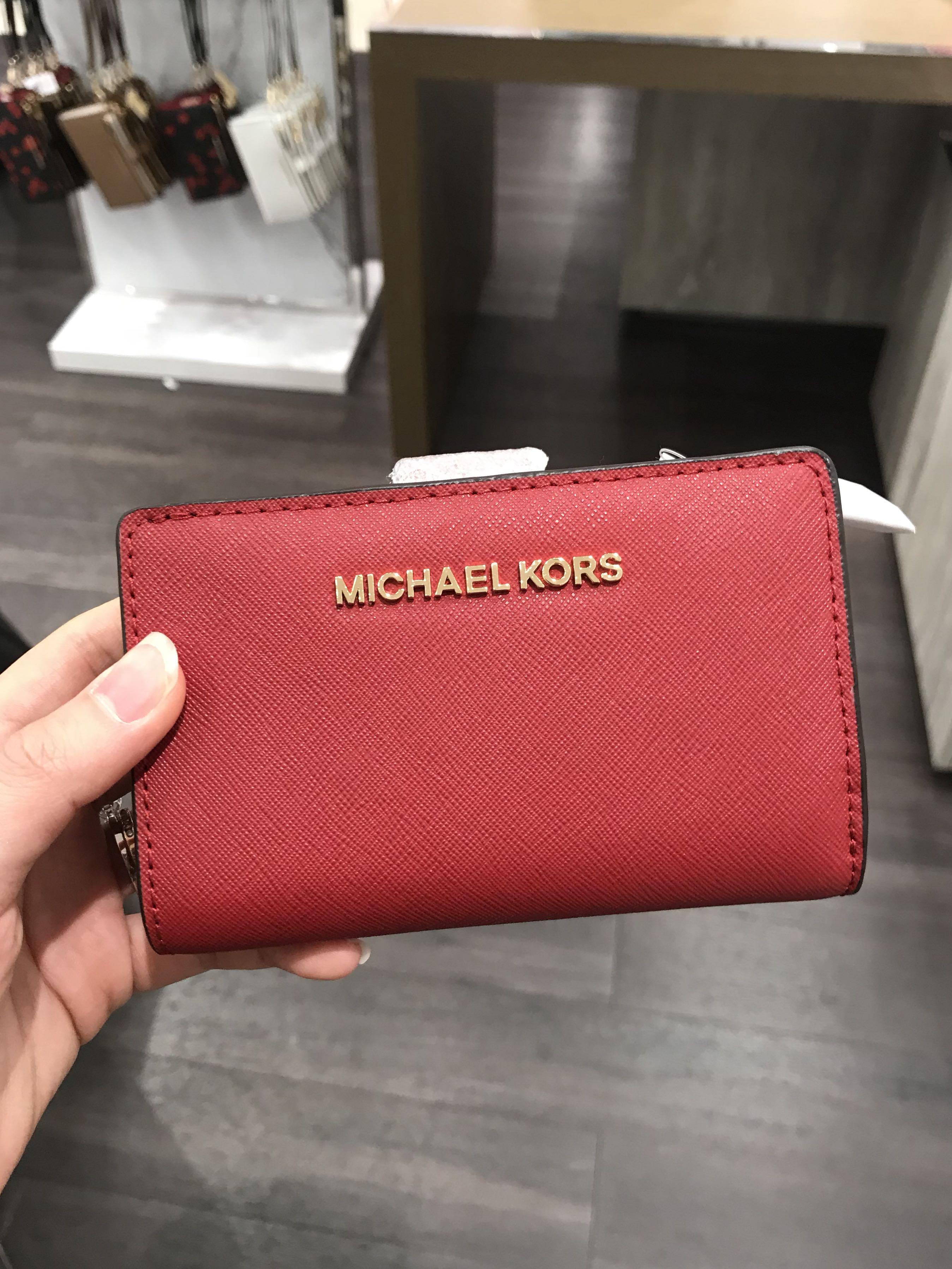 c1e9dfc3db3b Michael Kors Jet Set Travel Bifold Zip coin Wallet Red, Women's Fashion,  Bags & Wallets, Wallets on Carousell