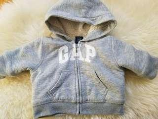 Baby Gap hoodie new condition. Size 0-3 mths but fits closer to 0 to 6 mths. Perfect for winter to keep baby photos. Purchased new for $39. Pick up Gerrard and Main street for $7 or $8 in Yorkville.