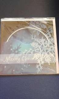 Free with ANY purchase. Xmas card with Carol cd