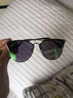 Purple and green reflective glasses