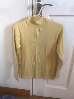 Yellow turtleneck long sleeved blouse