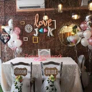 ROM table and chairs decoration with helium balloon clusters