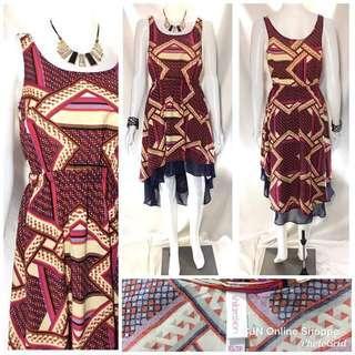 Beautiful hi-lo dress with very pretty prints