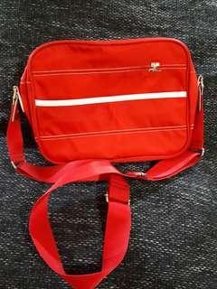 Courreges red sling bag