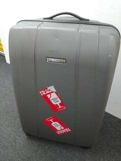 In very good condition Delsey 29in 4 wheel Silver luggage