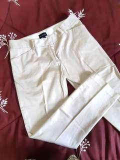 The executive slim fit trousers size 27, color cream/broken white