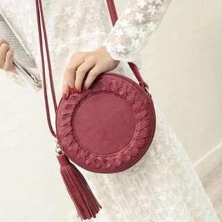 Round tassle sling bag