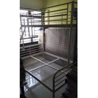 A white color metal queen size and single bump bed frame
