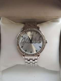 Authentic Guess watch for ladies with stainless steel bracelet