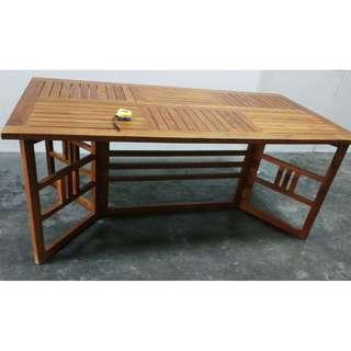A  solid wood folding table
