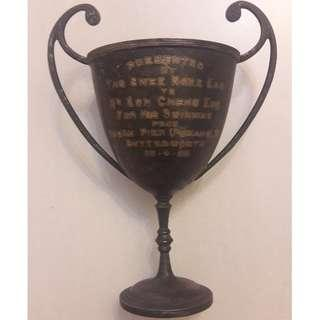 "Vintage 1925 trophy. Inscription reads ""PRESENTED BY TAN SWEE NGEE ESQ. TO MR GOH CHENG ENG FOR HIS SWIMMING FROM KEDAH PIER (PENANG) TO BUTTERWORTH 26-4-25"