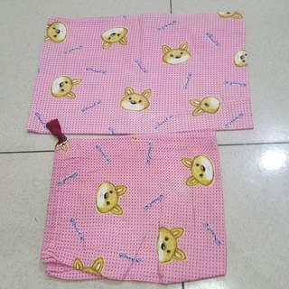 Sarung bantal bayi
