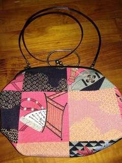 Kokon tozai sling bag