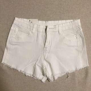 white high waist destressed shorts