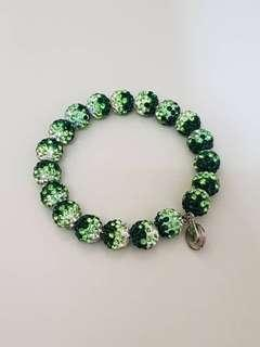 Round bead bracelet with mixture of green