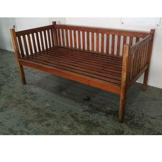 A solid wood day bed