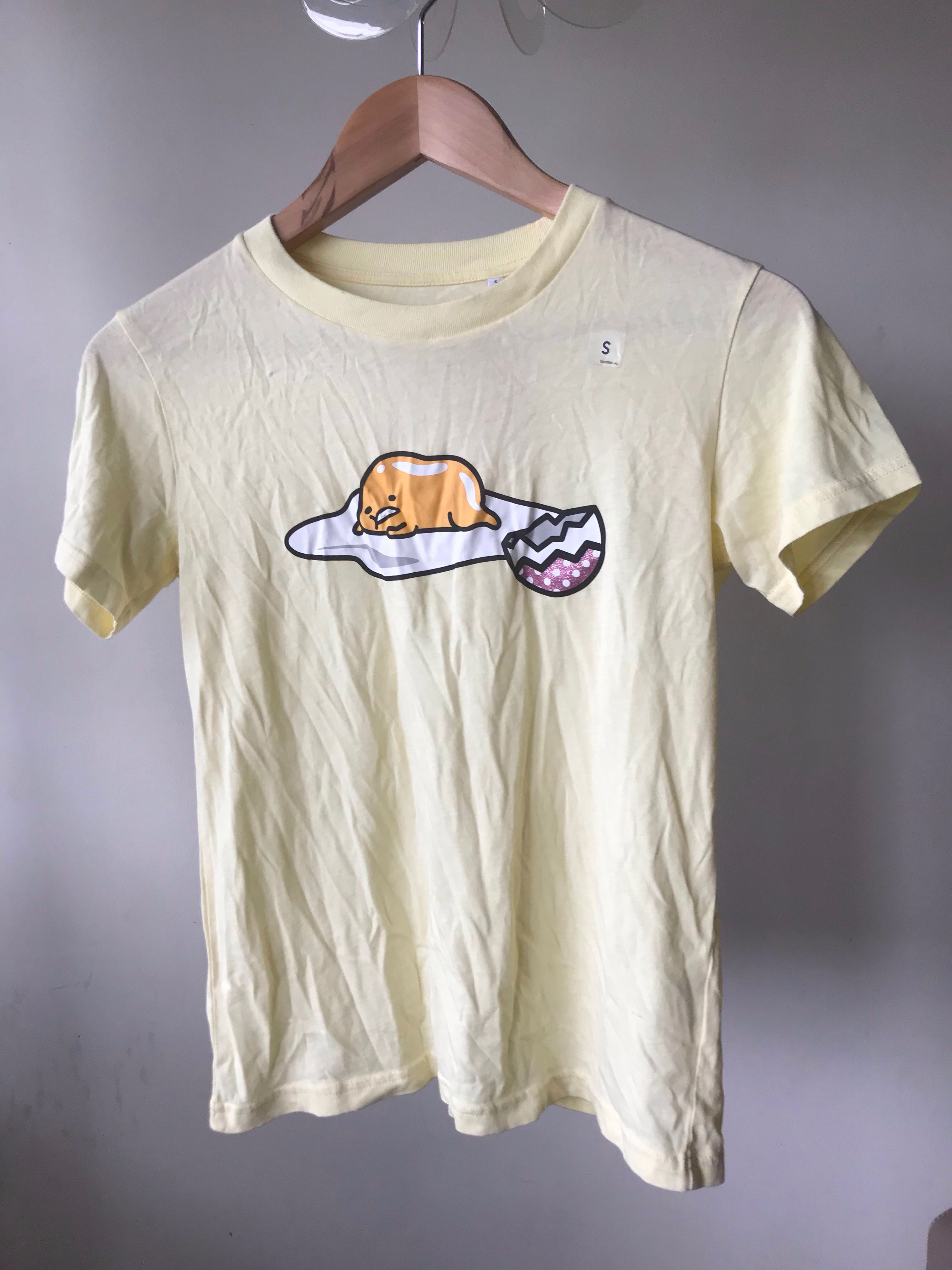 1f3b4193 [IN][BNWT] sanrio x uniqlo gudetama shirt, Women's Fashion, Clothes, Tops  on Carousell