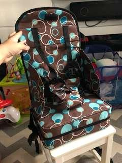 BRAND NEW portable booster seat