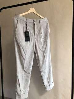 Loose fitting darted trousers