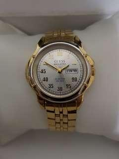 Authentic Guess watch for ladies with gold bracelet