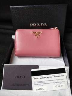 Authentic Prada multi colour wallet in pink saffiano