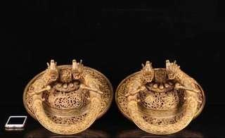 A pair of antique Tibetian gold plated bronze door rings