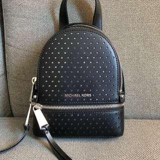 Authentic Michel Kors Rhea Mini Star Shaped Perforated Crossbody Pearl Black Leather Backpack