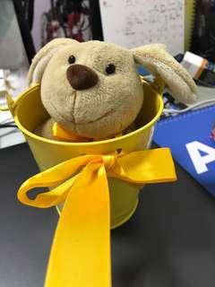 Dog plushie with yellow can